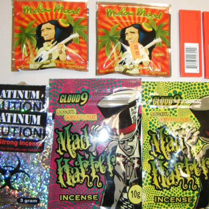 Colorful printed packets containing spice, showing cartoonish graphics.